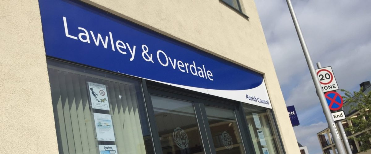 A photograph of the Lawley and Overdale Parish Council office, showing the main door and the council's logo above it