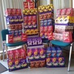 Multiple piles of boxed Easter eggs at various heights.