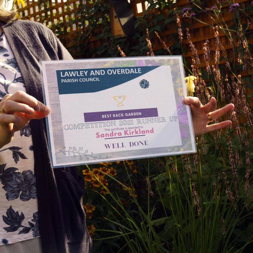 A close-up of a woman holding a certificate.
